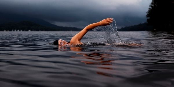 Man-lake-swimming-1024x516