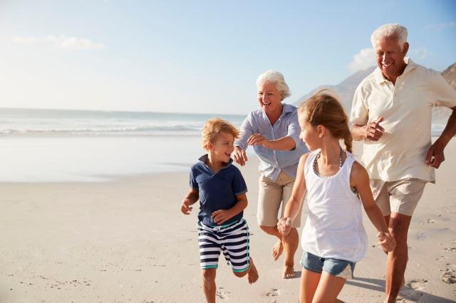 Grandparents-chasing-kids-on-beach-1-1.jpg