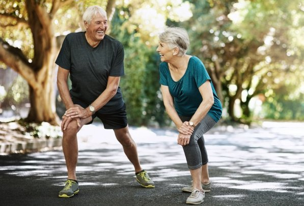 Shot of a senior couple warming up before a run outside
